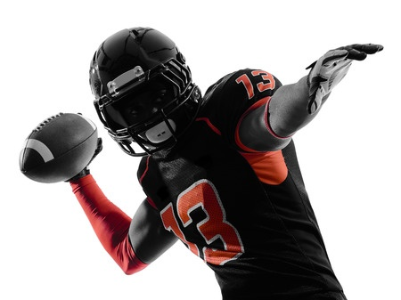 23309112 - one  american football player quarterback passing portrait in silhouette shadow on white background
